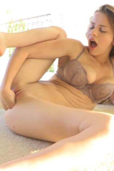 Busty girl in purple dress plays with vibrator Video