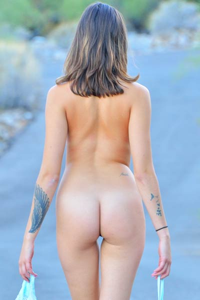 Public striptease outdoors by naughty and foxy Roxanna