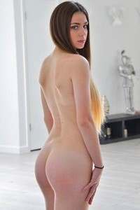 Skinny brunette gets full naked and shows us her tight ass